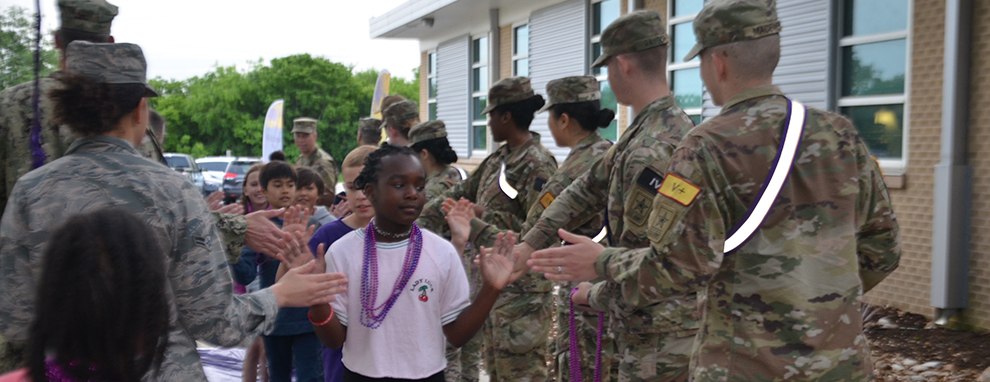 Joint Base San Antonio greets schoolchildren for 'Purple Up! For Military Kids' day