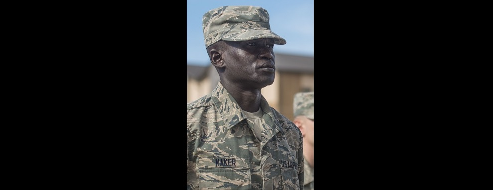 Gour Maker, a trainee at basic military training, stands in formation at the Coin Ceremony Feb. 1, 2018 outside the Pfingston Reception Center at Joint Base San Antonio-Lackland, Texas. During the BMT Coin Ceremony Maker was awarded an 'Airman's Coins' signifying his final transition from trainee to Airman.